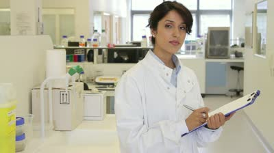 stock-footage-portrait-of-female-scientist-in-laboratory